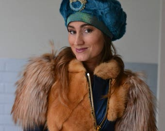 Turquois imitation fur cap with dragon brooch