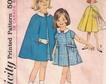 Simplicity 5477 Girl's Dress and Cape pattern