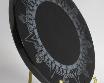Engraved black obsidian mirror - Sun crown of the Aztec calendar