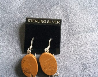 Adorable earth tone colored stone set on sterling silver wire and post.