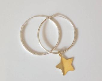 Silver hoop earrings with little star