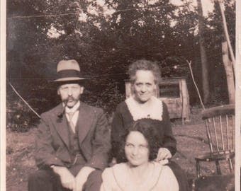 Photograph of a Mum, Dad & Daughter - Postcard - Blank - 1932.