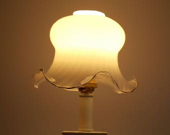 A vintage milky glass light shade, with crimped edges gold rim.