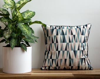 Geometric Cushion in Earthy Tones with Black Piping