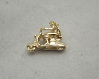 9 carat gold 3d charm of a girl riding a scooter