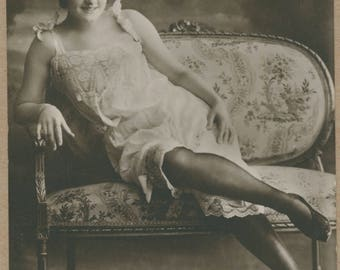 Sweet Thing Settee | Sensual Miss | 1910's - 1920's French Boudoir Postcard | Fine Lace Lingerie | Black Stockings | Dark Clouds |