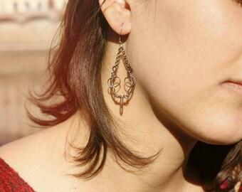 Swing earrings in copper and silver
