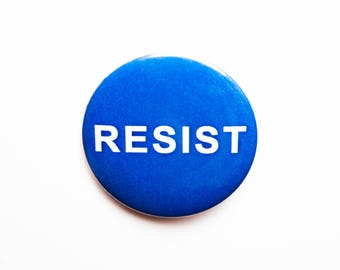 2 1/4 inch pin/button RESIST with a Blue background