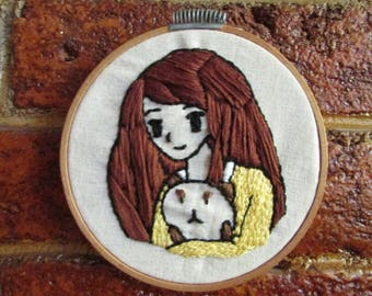 "Frame with handmade embroidery ""Girl with Kitten"""