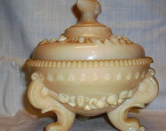 Listing 200 is an anitque westmoreland 3 searpant footed candy dish