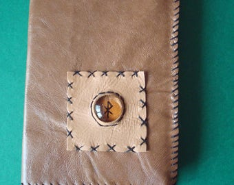 leather book and its symbol runes book