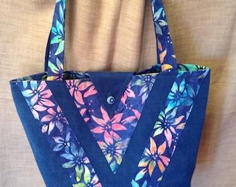 Blue canvas bag and multicolor batik fabric.