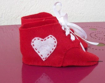 Red felt baby shoes