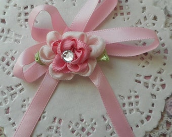 Pink satin bow with 2 shades of pink and flower rhinestone in the Center 7,00 cm in height