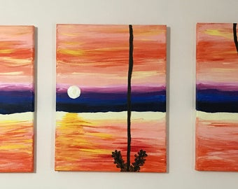 Three piece sunset canvas painting