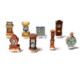 Beans clocks, clock, wind chime... Collection of old miniature masters of time, vintage objects beans, France, Epiphany