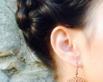 Earring is handmade by LeaCrea 30, crocheted with brown colored copper wire.