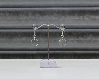 dots O O -  laser cut clear earrings