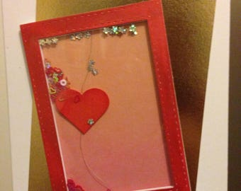 Card with heart window