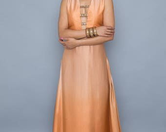 Indian Inspired long dress with plunging neckline and gold trims
