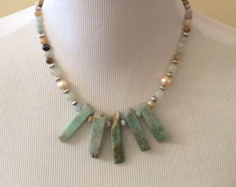"""Beautiful Chrysophrase gemstones are the focal point of this """"tooth"""" necklace."""