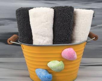 Yellow Beach Bathroom Bin - Beach Bathroom - Bathroom Wash Cloth Holder with Seashells.  4 dark gray wash cloths and 6 white wash cloths