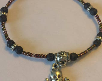 Skull charm bracelet with lava stones