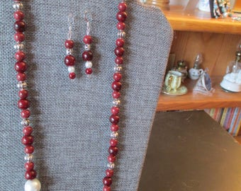 Red beaded necklace with offset focal point