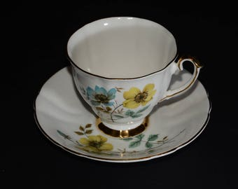 WINDSOR, Bone China, Teacup, and saucer, footed cup with matching saucer,  yellow and blue flowers, mint condition, vintage teacup, England