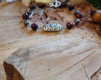 Bracelet arabesque en oeil de tigre rouge et hématite 20.5cm -Pierres de protection et d'énergie.-
