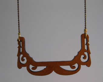 Pendant carved in wood by Corkjewelery.