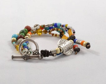 Unique, Eye Catching Multi Strand Beaded Bracelet with Leather Accent
