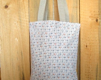 White bag with polka dots