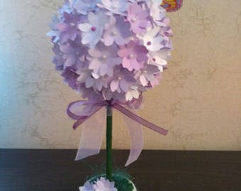 Topiary made with paper flowers.