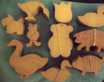 200+ wood cutouts of animals to paint for many uses in craft projects.