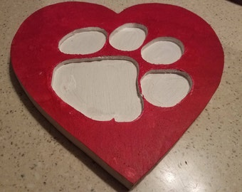 Clemson paw carved into heart