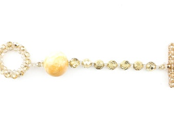 Bracelet with t-bar closure, glossy crystals and one large Siena yellow marble sphere