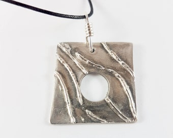 Silver pendant with Silver detail
