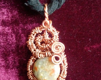 Wire wrapped Unakite pendant