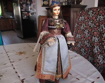 """Vintage Greek Vinyl Doll with Painted Face and Traditional Costume. 14"""" High. Doll Stand."""