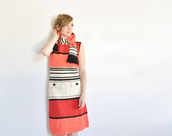 so very mod 1960 scooter dress . red orange striped with matching scarf .medium