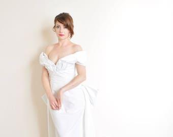 off the shoulder bombshell wedding gown . bustle back rose bridal dress .medium