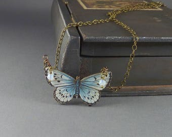 Breezy. Butterfly Necklace. modern. delicate. whimsical. brass necklace with glass beads and wooden butterfly pendant.