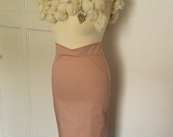 Powder Pink Mistress pencil skirt with quilted insert panels on the hips. Available in sizes XS-XL and made to measure.