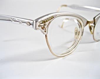 Vintage cat eye glasses aurora borealis rhinestones. Silver aluminum filigree ornate frames. Art-Craft 46-22.