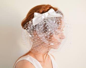 White polka dot blusher bridal haircomb with silk bow