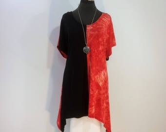 Plus size 2X black and watermelon tie dye tunic top with scoop neck, cap sleeves, and sharkbite hem in bamboo blend featherweight fabric.