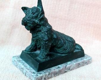 Cast bronze metal scottie dog on stone base.