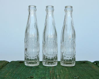 Classic Italian embossed glass 'gassosa' bottles from Popoli