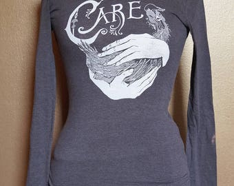 """Small """"Care"""" Long Sleeved Tee, White Ink on Grey"""